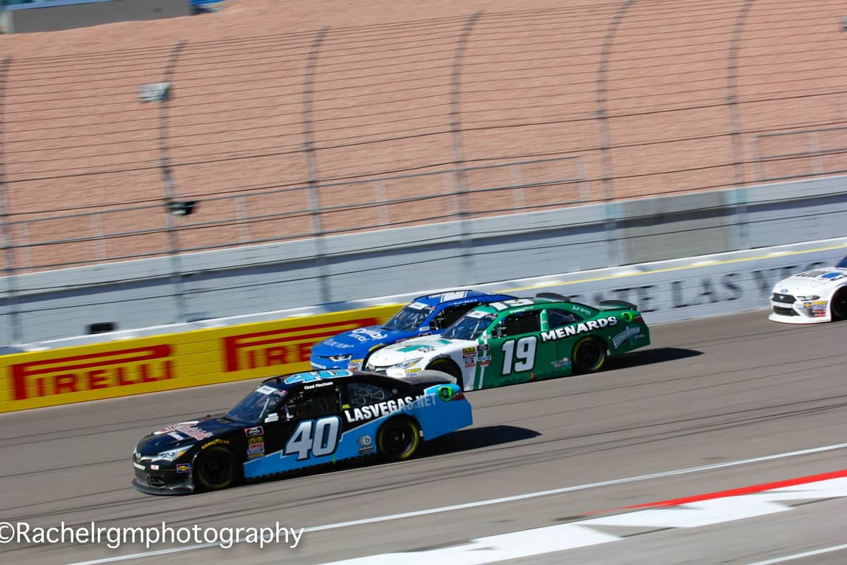 Elliott Sadler (outside), Brandon Jones (middle) and Chad Finchum (inside) battle three-wide at Las Vegas Motor Speedway.