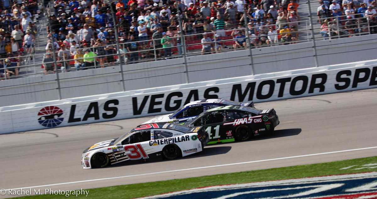 Jamie McMurray (outside), Kurt Busch (middle) and Ryan Newman (inside) race three-wide on the front stretch at Las Vegas Motor Speedway.