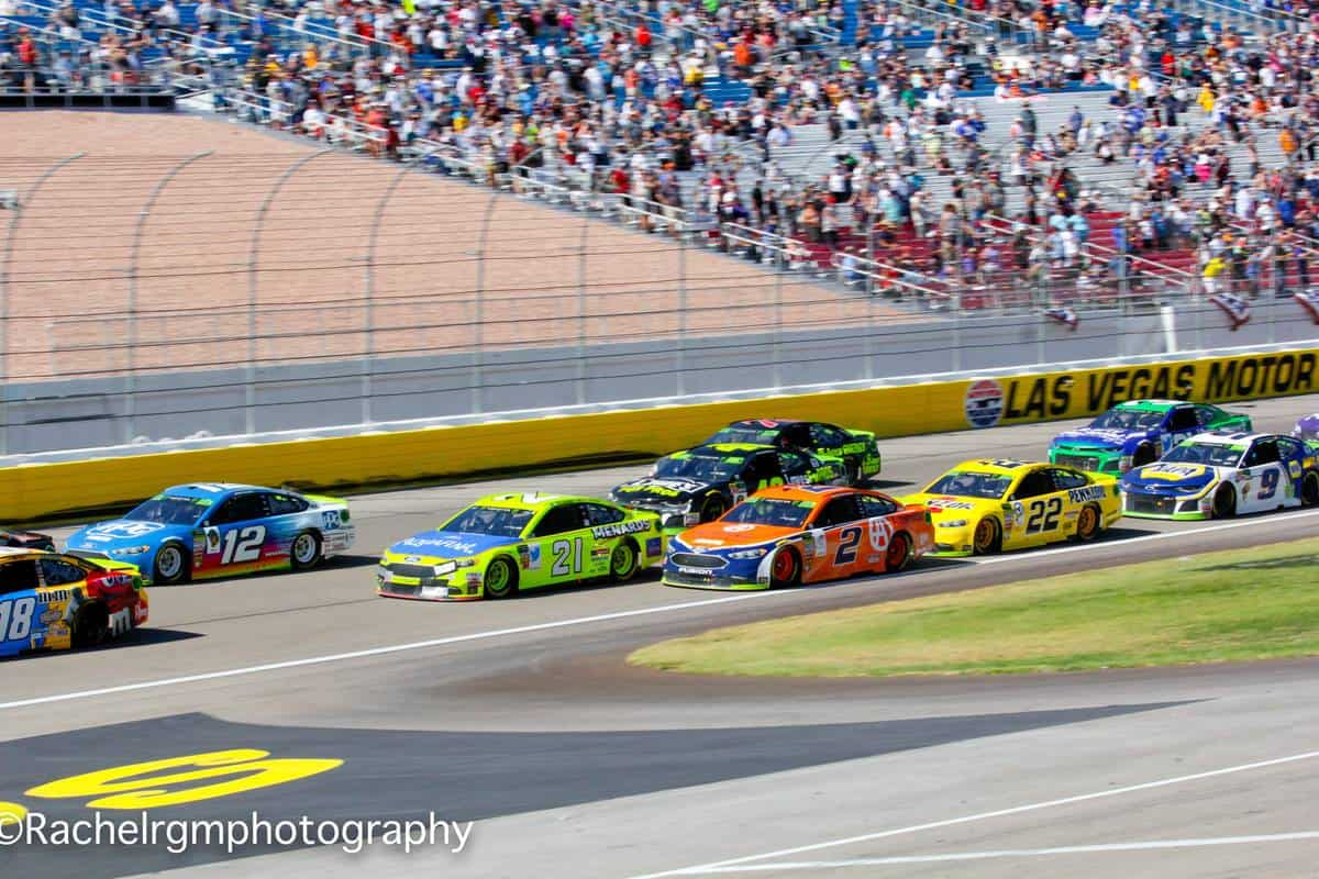 The Monster Energy NASCAR Cup Series heads into Turn 1 after a restart at Las Vegas Motor Speedway.